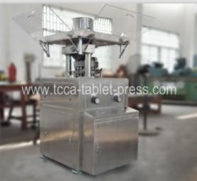 Metal powder tablet press